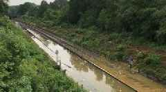 UK weather: Heavy rain causes road and rail chaos