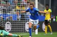 Italy's Cristiana Girelli scores her 2nd goal with her thigh