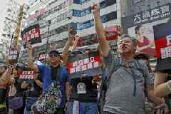Hong Kong on security alert as thousands march in fresh wave of protests