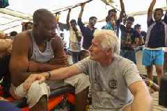 Richard Gere visits migrants stranded in Mediterranean for more than a week