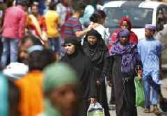 Call waiting: Kashmiris queue for two-minute phone access ahead of Eid