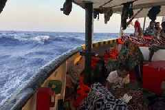Migrant ship with 150 on board arrives near Italian island after judge overrules Salvini's ban