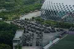 China flexes muscle near Hong Kong amid more weekend rallies