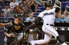 Marlins overpowered by Mike Moustakas' homers, fall to Brewers for a series loss