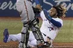 Alford hits winning HR in 15th, Blue Jays beat Orioles 11-10