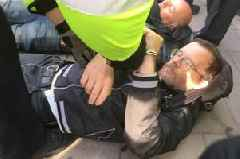Birmingham priest arrested as he lay on the ground praying while blocking London City Airport entrance in mass Extinction Rebellion protest
