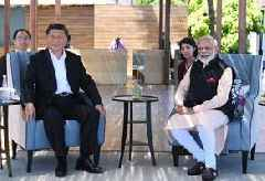 India and China seek 'new era' in ties after leaders meet