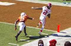 CeeDee Lamb takes a hit and stays in bounds for his third TD catch of the Red River Showdown