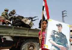 Assad's army marches in on the Kurdish zone near the Turkish border