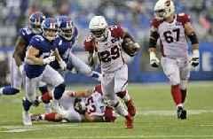 Edmonds runs for 3 TDs, Cards top Giants in Barkley's return