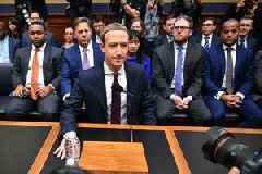 Mark Zuckerberg said Facebook would drop out of its controversial payments project if US regulators don't approve it (FB)