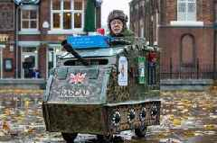 Poppy seller turns mobility scooter into tank for Remembrance Sunday