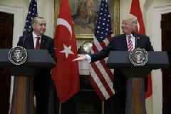 Erdogan says U.S. not fulfilling Syria deal ahead of Trump talks