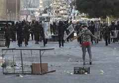 Iraq protesters storm Baghdad bridge, medic killed