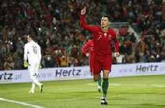 Ronaldo scores hat trick as Portugal routs Lithuania 6-0