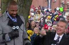 Urban Meyer gets hostile welcome from Michigan fans; Charles Woodson receives heroes welcome