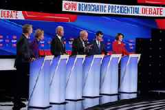 Warren and Sanders Spar, Bloomberg's Twitter Trolls and 2 Other Highlights From 7th Democratic Debate