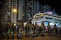 HK pro-democracy protesters beat police officers