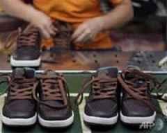 Coronavirus slams Adidas, Puma sales in China
