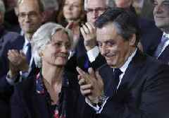 Former French prime minister and wife in court for embezzling