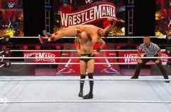 Cesaro takes down Drew Gulak with a no-hand airplane spin on the WrestleMania kick off show