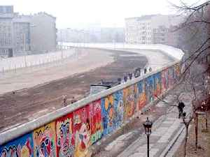 Berlin Wall: Barrier constructed by the German Democratic Republic, enclosing West Berlin