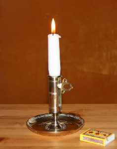 Candle: Solid block of wax with embedded wick