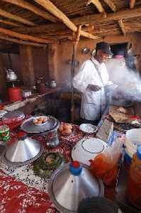 Cooking: Art of preparing food for consumption with the use of heat
