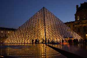 Louvre Pyramid: Glass and metal pyramid in the main courtyard of the Louvre Palace