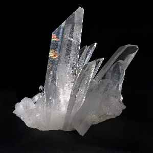 Quartz: Mineral composed of silicon and oxygen atoms in a continuous framework of SiO₄ silicon–oxygen tetrahedra, with each oxygen being shared between two tetrahedra, giving an overall chemical formula of SiO₂
