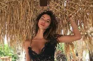 Ex-Tottenham star's new girlfriend is topless model who invented upside down bikini