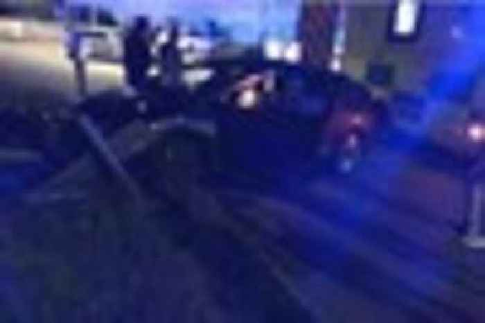 Man Cut From Car After Crashing Into Road Sign On
