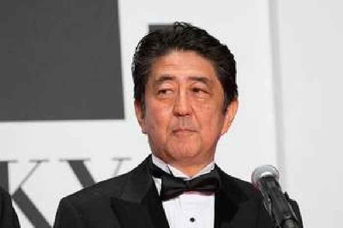 Japan's Abe, headed for longest premiership, seeks stability in cabinet rejig