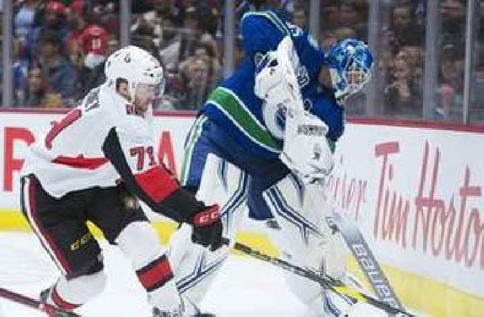 roussel scores in return canucks beat senators 5 2 one news page. Black Bedroom Furniture Sets. Home Design Ideas