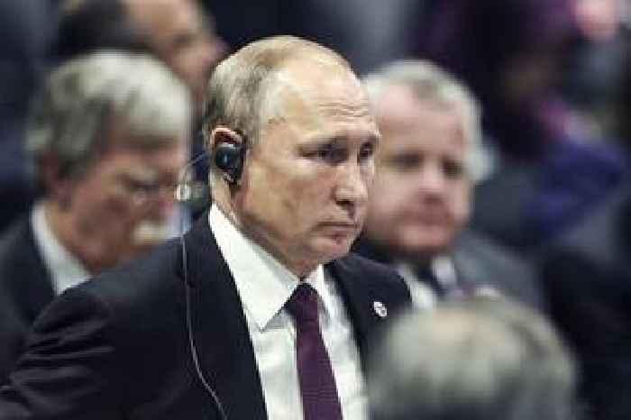 Russia's Putin makes rare visit to Syria, meets Assad