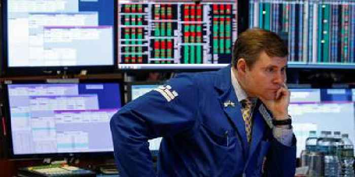 Dow plummets more than 1,300 points to 3-year low as investors panic over coronavirus