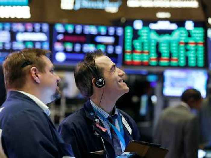 Dow caps off best quarter since 1987 as strong economic data drives gains