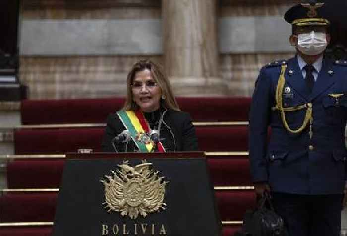 Bolivia's 'interim president' withdraws from upcoming election, one day after poll shows pro-Morales candidate in the lead