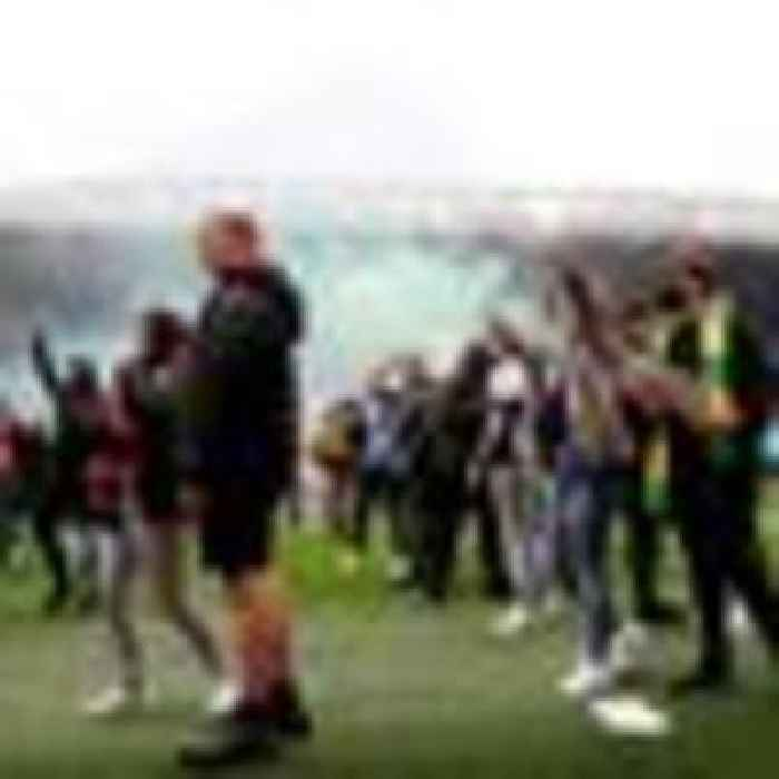 Man Utd say fans broke barriers and climbed gates to storm pitch - and deny staff allowed access