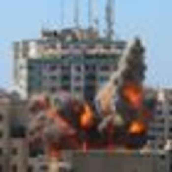 Israeli airstrikes topple media tower and hit home of Hamas leader as Gaza death toll rises