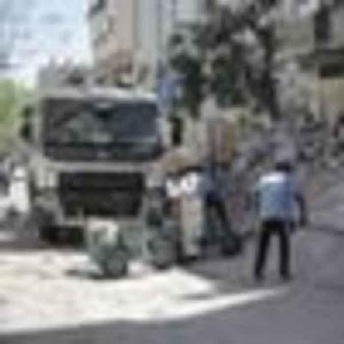 Israel-Hamas ceasefire holds as humanitarian aid arrives in Gaza