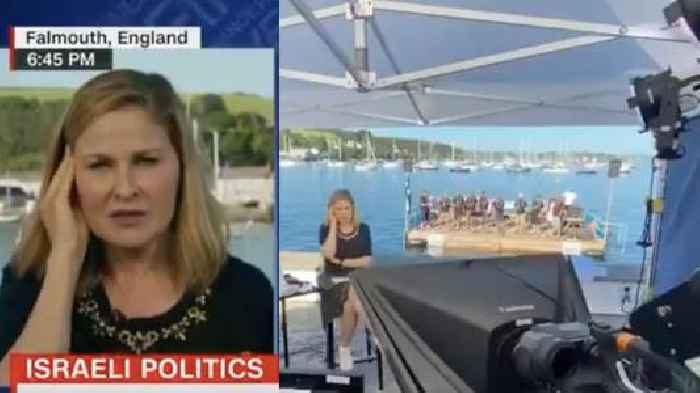 Watch a CNN Anchor Get Drowned Out by Sailors Singing a Shanty (Video)
