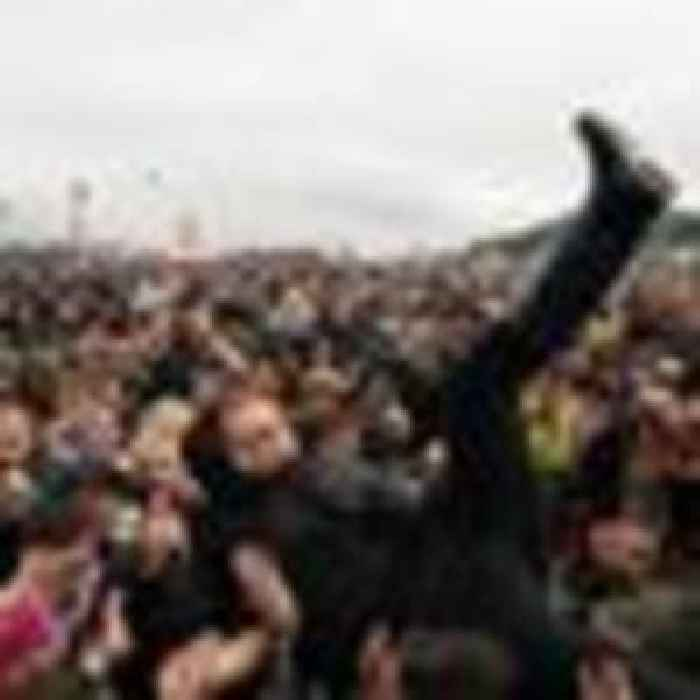 Mosh pits, ponchos and mask-free crowds: 'Euphoria' as revellers brave rain at Download Festival