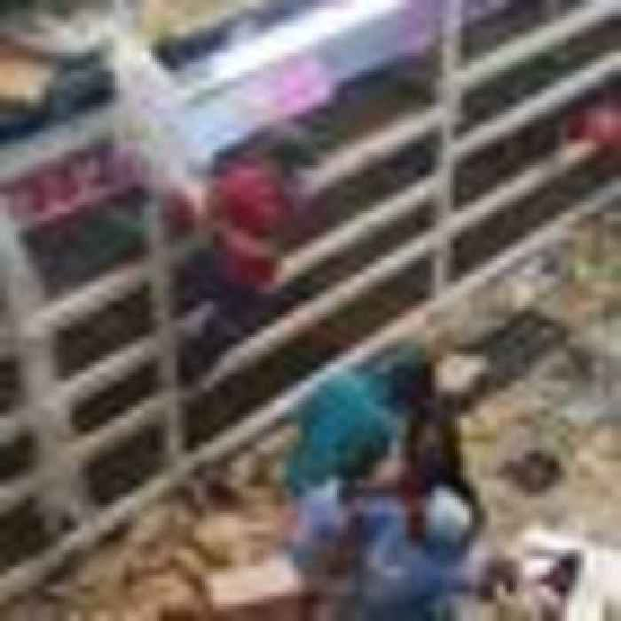 Ten killed in stampede during looting of South African shopping centre as rioting continues