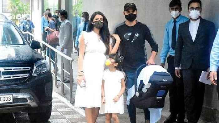 Photo: Harbhajan Singh and Geeta Basra with newborn son at a hospital in Khar