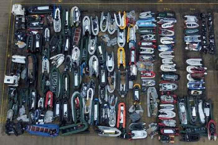 Drone pictures show dozens of migrant dinghies stacked up in Dover compound