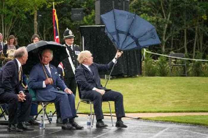 WATCH: UK Prime Minister Boris Johnson's Vaudevillian Struggles With an Umbrella Go Viral