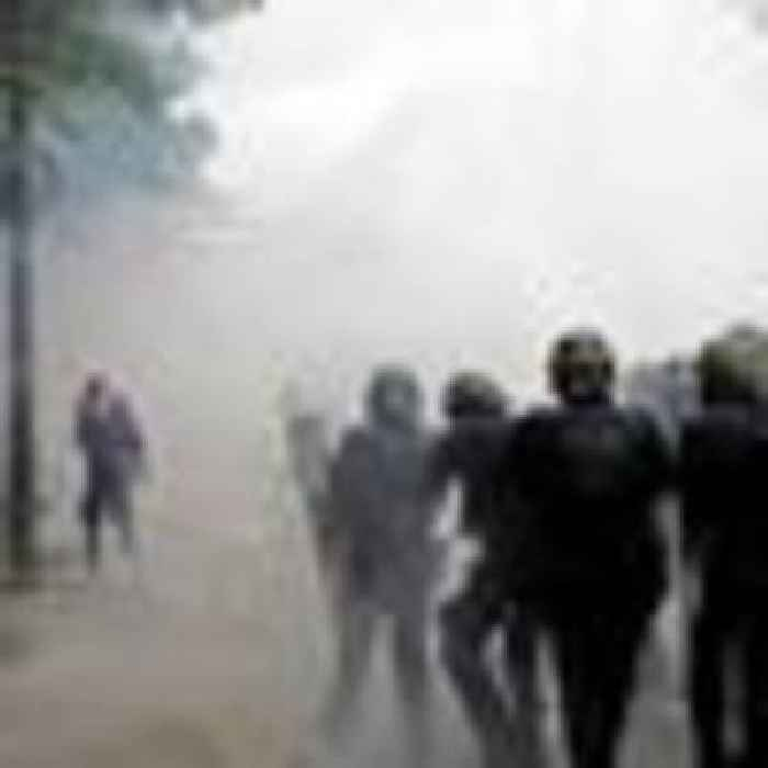 Tear gas fired amid clashes at vaccine passport protests in Paris
