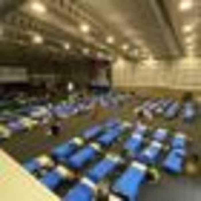 Paratroopers self-isolate on camp beds in sports hall after evacuating people from Afghanistan