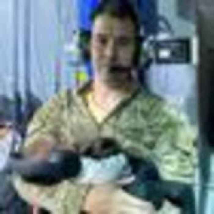 RAF man cradled Afghan newborn dropped by exhausted mother on evacuation flight from Kabul